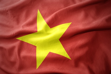 waving colorful national flag of vietnam. Stock Photo
