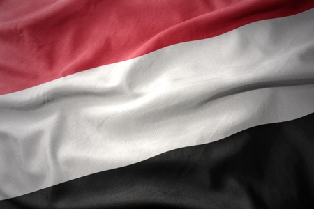 micro print: waving colorful national flag of yemen. Stock Photo