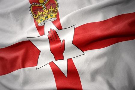 waving colorful national flag of northern ireland. Stock Photo