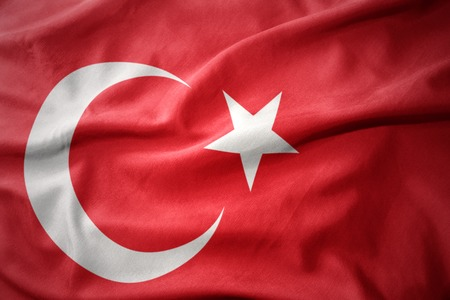 micro print: waving colorful national flag of turkey.