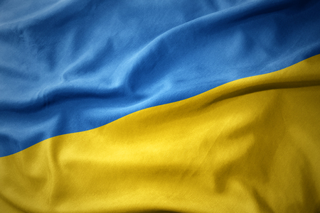 waving colorful national flag of ukraine. Stock Photo