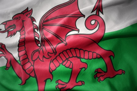 waving colorful national flag of wales. Stock Photo