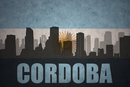 abstract silhouette of the city with text Cordoba at the vintage argentinean flag background Фото со стока