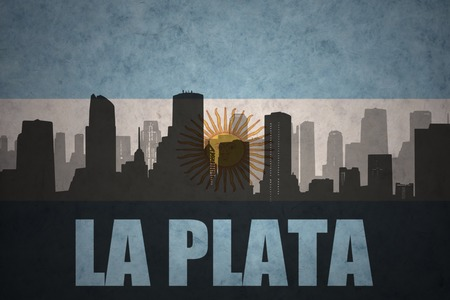 clash: abstract silhouette of the city with text La Plata at the vintage argentinean flag background