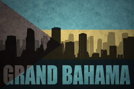 bahama: abstract silhouette of the city with text Grand Bahama at the vintage bahamas flag background