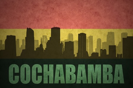 cochabamba: abstract silhouette of the city with text Cochabamba at the vintage bolivian flag background Stock Photo