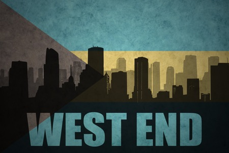 west end: abstract silhouette of the city with text West End at the vintage bahamas flag background