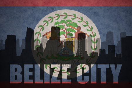 clash: abstract silhouette of the city with text Belize City at the vintage belize flag background