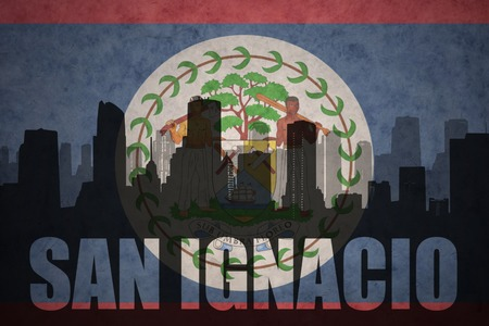 ignacio: abstract silhouette of the city with text San Ignacio at the vintage belize flag background
