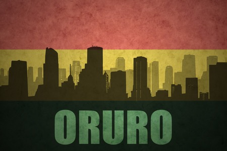 bolivian: abstract silhouette of the city with text Oruro at the vintage bolivian flag background