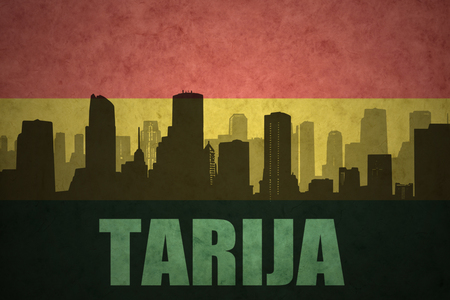 clash: abstract silhouette of the city with text Tarija at the vintage bolivian flag background Stock Photo