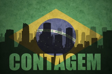 clash: abstract silhouette of the city with text Contagem at the vintage brazilian flag background