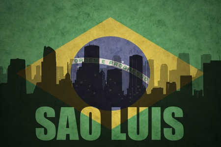 clash: abstract silhouette of the city with text Sao Luis at the vintage brazilian flag background Stock Photo