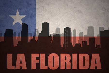 bandera chilena: abstract silhouette of the city with text La Florida at the vintage chilean flag background Foto de archivo
