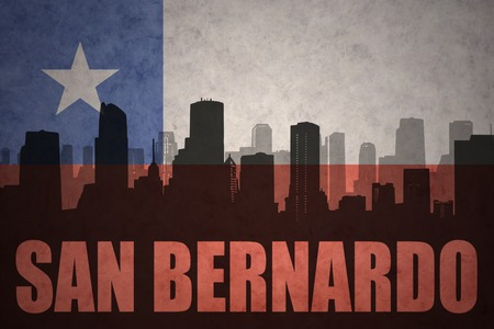 bandera chilena: abstract silhouette of the city with text San Bernardo at the vintage chilean flag background Foto de archivo