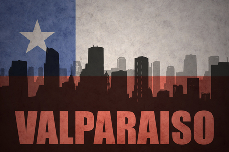 bandera chilena: abstract silhouette of the city with text Valparaiso at the vintage chilean flag background