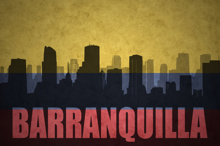 colombian: abstract silhouette of the city with text Barranquilla at the vintage colombian flag background