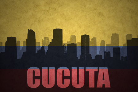 colombian flag: abstract silhouette of the city with text Cucuta at the vintage colombian flag background Stock Photo