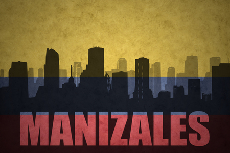colombian flag: abstract silhouette of the city with text Manizales at the vintage colombian flag background