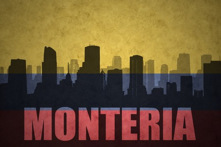 colombian flag: abstract silhouette of the city with text Monteria at the vintage colombian flag background