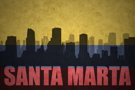 marta: abstract silhouette of the city with text Santa Marta at the vintage colombian flag background