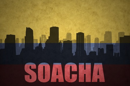 colombian flag: abstract silhouette of the city with text Soacha at the vintage colombian flag background Stock Photo