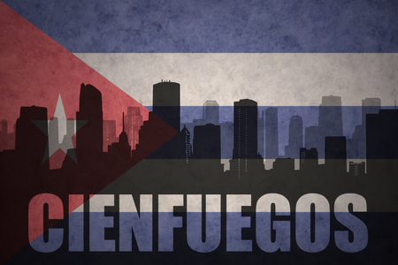 clash: abstract silhouette of the city with text Cienfuegos at the vintage cuban flag background