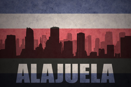 clash: abstract silhouette of the city with text Alajuela at the vintage costa rican flag background Stock Photo