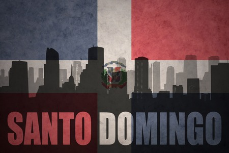 santo domingo: abstract silhouette of the city with text Santo Domingo at the vintage dominican republic flag background Stock Photo