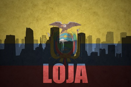 loja: abstract silhouette of the city with text Loja at the vintage ecuadorian flag background
