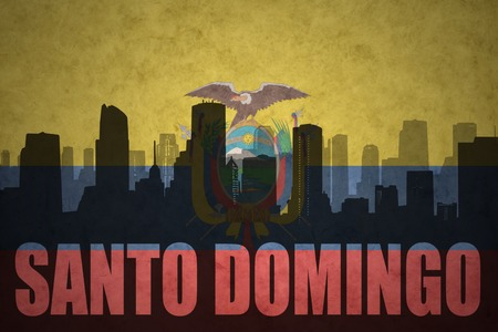 santo domingo: abstract silhouette of the city with text Santo Domingo at the vintage ecuadorian flag background Stock Photo