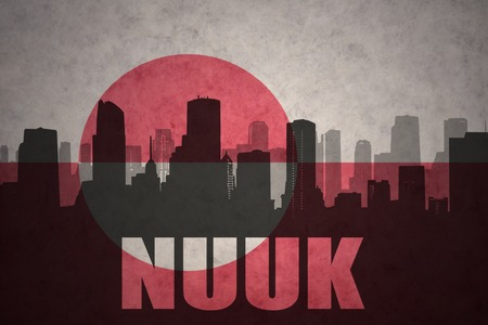 nuuk: abstract silhouette of the city with text Nuuk at the vintage greenland flag background
