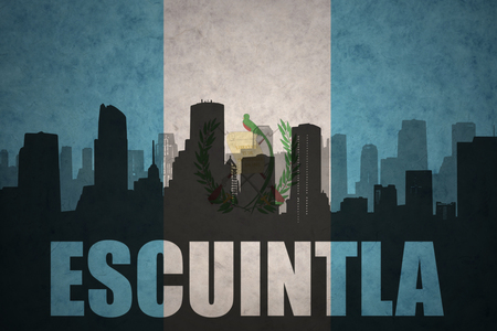 guatemalan: abstract silhouette of the city with text Escuintla at the vintage guatemalan flag background
