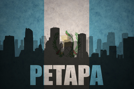guatemalan: abstract silhouette of the city with text Petapa at the vintage guatemalan flag background