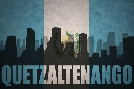 guatemalan: abstract silhouette of the city with text Quetzaltenango at the vintage guatemalan flag background