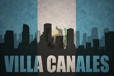 guatemalan: abstract silhouette of the city with text Villa Canales at the vintage guatemalan flag background