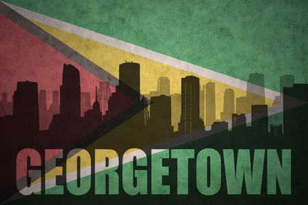 georgetown: abstract silhouette of the city with text Georgetown at the vintage guyana flag background