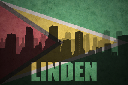 guyanese: abstract silhouette of the city with text Linden at the vintage guyana flag background