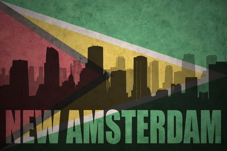 guyanese: abstract silhouette of the city with text New Amsterdam at the vintage guyana flag background