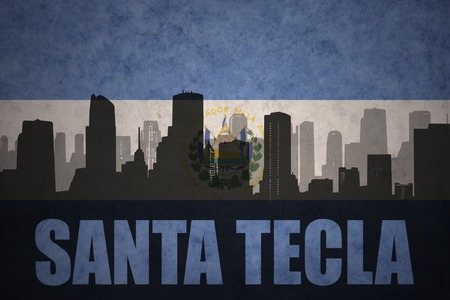 clash: abstract silhouette of the city with text Santa Tecla at the vintage salvadoran flag background Stock Photo