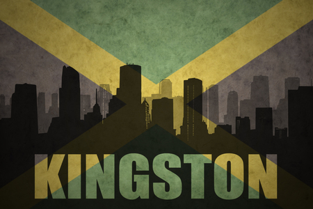 kingston: abstract silhouette of the city with text Kingston at the vintage jamaican flag background