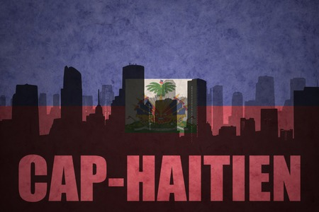 haitian: abstract silhouette of the city with text Cap-Haitien at the vintage haitian flag background