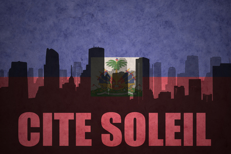 haitian: abstract silhouette of the city with text Cite Soleil at the vintage haitian flag background