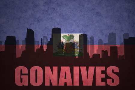 haitian: abstract silhouette of the city with text Gonaives at the vintage haitian flag background Stock Photo