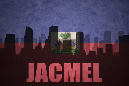 haitian: abstract silhouette of the city with text Jacmel at the vintage haitian flag background Stock Photo