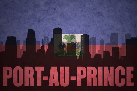 haitian: abstract silhouette of the city with text Port-au-Prince at the vintage haitian flag background Stock Photo