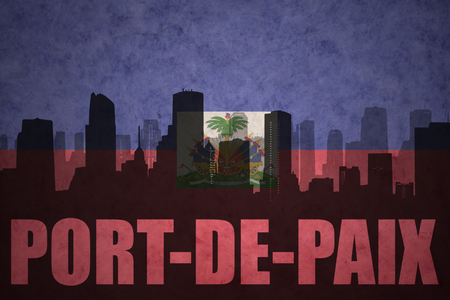 haitian: abstract silhouette of the city with text Port-de-Paix at the vintage haitian flag background Stock Photo