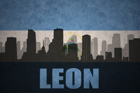 leon: abstract silhouette of the city with text Leon at the vintage nicaraguan flag background