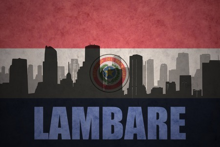 clash: abstract silhouette of the city with text Lambare at the vintage paraguayan flag background