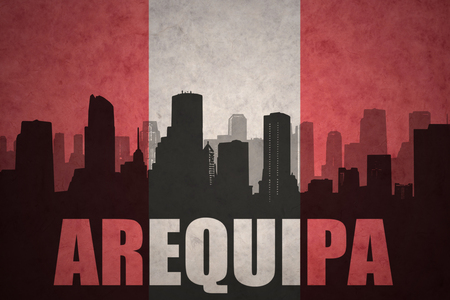 peruvian: abstract silhouette of the city with text Arequipa at the vintage peruvian flag background Stock Photo
